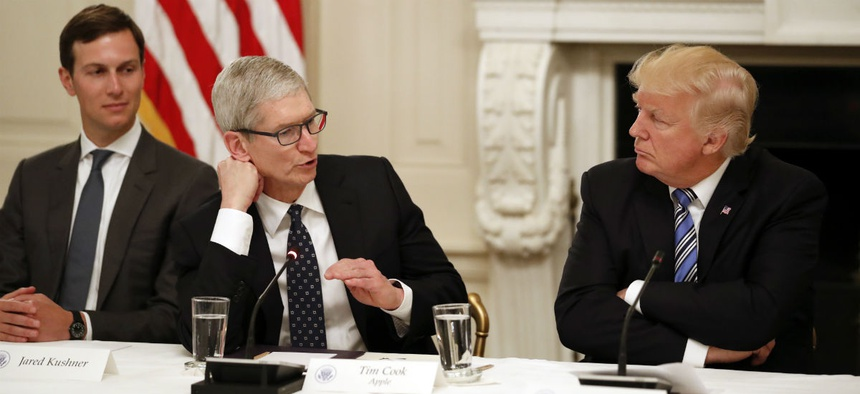 Apple's Time Cook speaks to President Donald Trump during an American Technology Council meeting.
