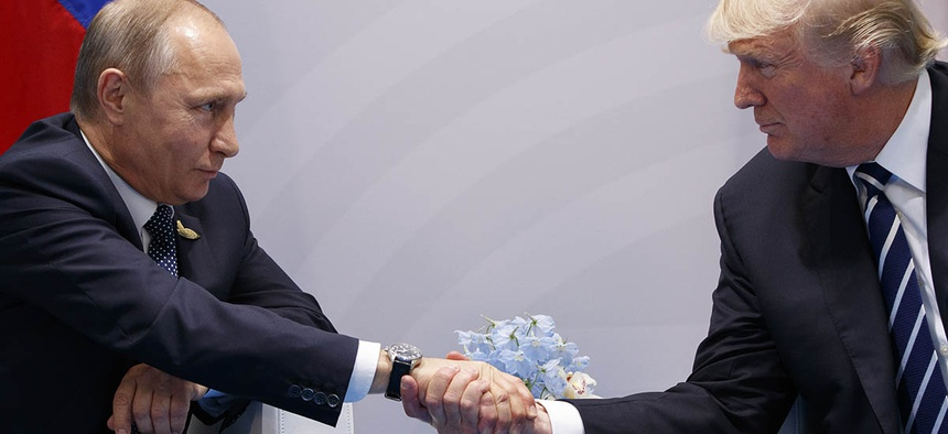 President Donald Trump shakes hands with Russian President Vladimir Putin at the G20 Summit, Friday, July 7, 2017.