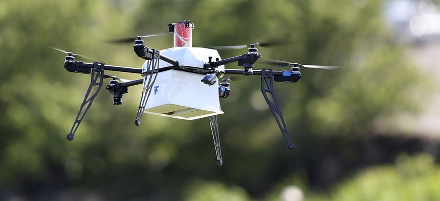 A drone aircraft with a payload of simulated blood flies during a ship-to-shore delivery simulation in Lower Township, N.J.