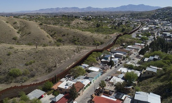A drone's view of the US-Mexico border fence as seen from Nogales, Mexico, Sunday, April 2, 2017.