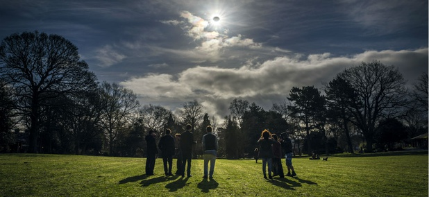 People watch a partial eclipse in Belfast, Northern Ireland, on March 20, 2015.