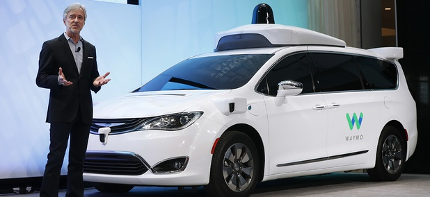 John Krafcik, CEO of Waymo, introduces a Chrysler Pacifica hybrid outfitted with Waymo's own suite of sensors and radar.
