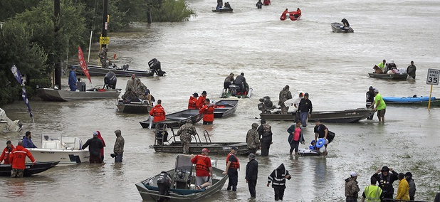 Rescue boats fill Tidwell Road as they help flood victims evacuate as floodwaters from Tropical Storm Harvey rise Monday, Aug. 28, 2017, in Houston.