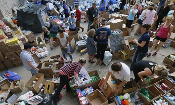 Donated items sit in a loading dock are as volunteers works to organize the items donated for Hurricane Harvey victims, Tuesday, Aug. 29, 2017, in Dallas, Texas.