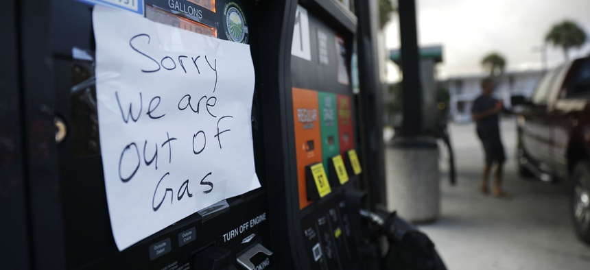A note is posted to a gas pump after the station ran out of gas ahead of Hurricane Irma in Daytona Beach, Fla., Friday, Sept. 8, 2017.