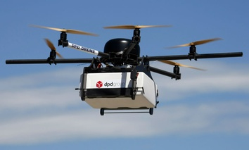 A DPD Geopost prototype drone files carrying a parcel flies during a test flight in Pourrieres, southern France, June 23, 2015.