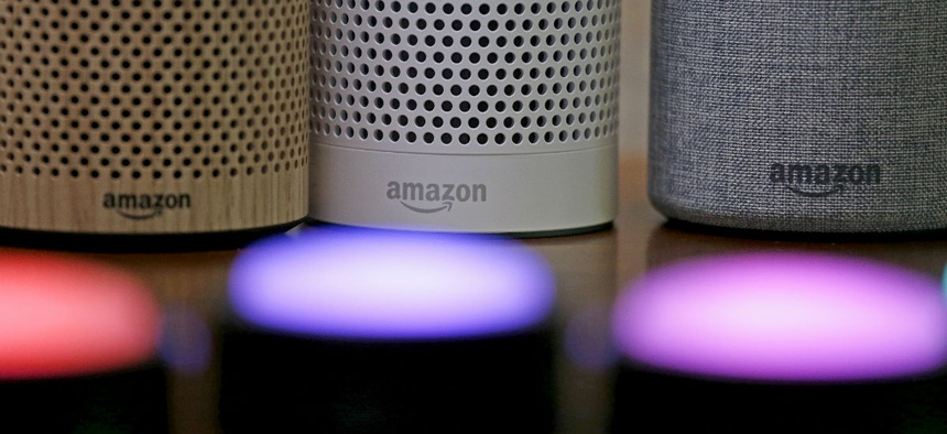 Amazon Echo and Echo Plus devices, behind, sit near illuminated Echo Button devices during an event announcing several new Amazon products by the company, Wednesday, Sept. 27, 2017, in Seattle.