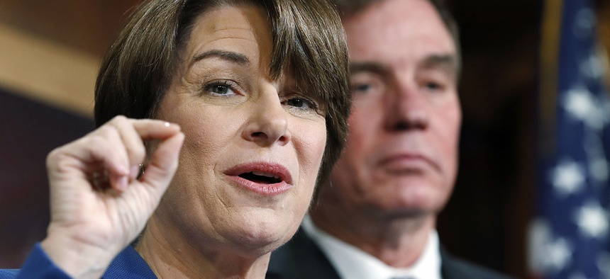 Sen. Amy Klobuchar, D-Minn., left, and Sen. Mark Warner, D-Va.