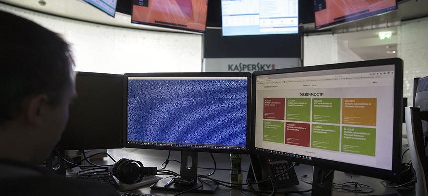 An employee of Kaspersky Lab works on computers at the company's headquarters in Moscow, Russia, Saturday, July 1, 2017.
