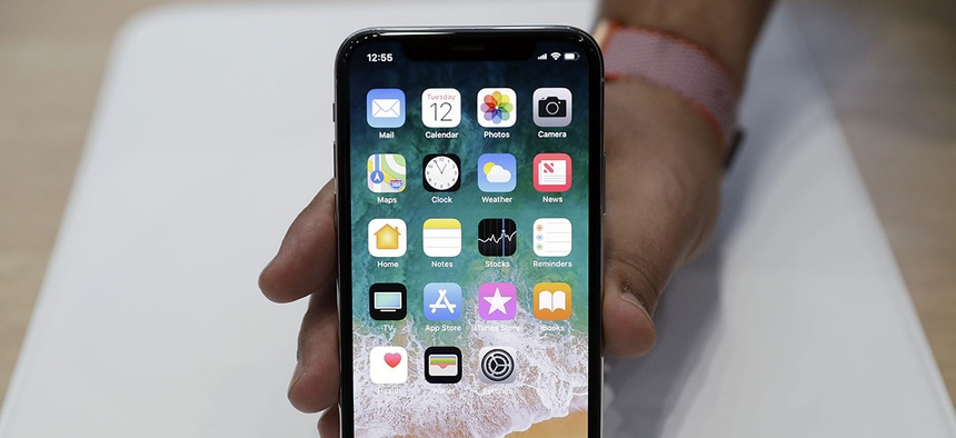 The new iPhone X is displayed in the showroom after the new product announcement at the Steve Jobs Theater on the new Apple campus in Cupertino, Calif.
