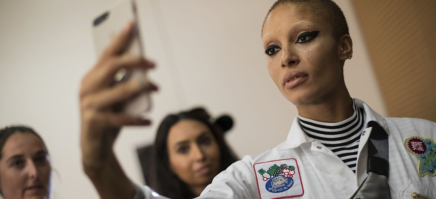 Model Adwoa Aboah takes a selfie backstage prior to the Versus Spring/Summer 2018 runway show at London Fashion Week in London, Sunday, Sept. 17, 2017.