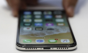 The new iPhone X is displayed in the showroom after the new product announcement at the Steve Jobs Theater on the new Apple campus on Tuesday, Sept. 12, 2017.
