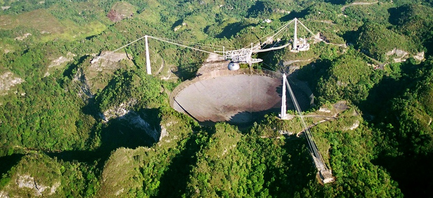 The world's largest radio telescope is seen from the air in this Wednesday, March 26, 2003 photo at the Arecibo Observatory, Puerto Rico.