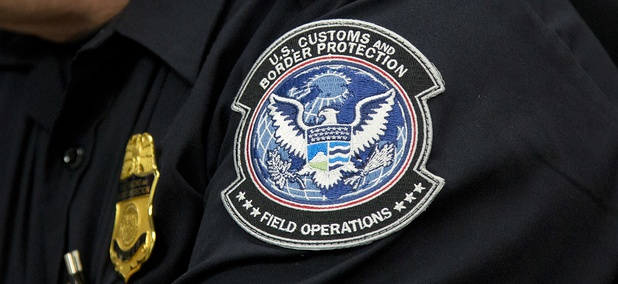 A customs agent wears a patch for the U.S. Customs and Border Protection agency, which is a part of the Department of Homeland Security, Friday, Oct. 27, 2017, at John F. Kennedy International Airport in New York.