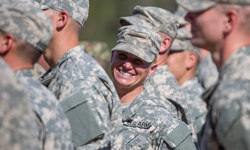 Maj. Lisa Jaster, center, stands in formation with other Rangers during an Army Ranger school graduation ceremony, Friday, Oct. 16, 2015, in Fort Benning, Ga. Jaster, who is the first Army Reserve female to graduate the Army's Ranger School.