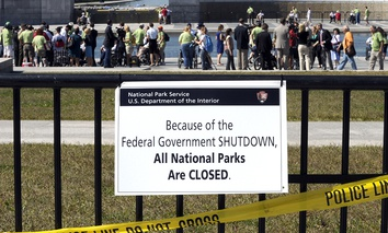 In 2013, people visited the closed World War II Memorial on the National Mall in Washington, despite signs stating that the national parks are closed due to the federal shutdown.