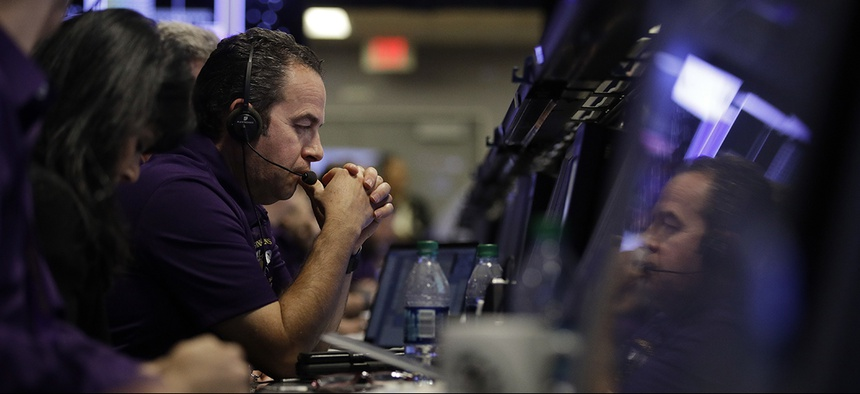 IO manager Luis Morales monitors the status of NASA's Cassini spacecraft in mission control at NASA's Jet Propulsion Laboratory, Friday, Sept. 15, 2017, in Pasadena, Calif.
