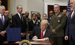 President Donald Trump signs the National Defense Authorization Act for Fiscal Year 2018, in the Roosevelt Room of the White House, Tuesday, Dec. 12, 2017.
