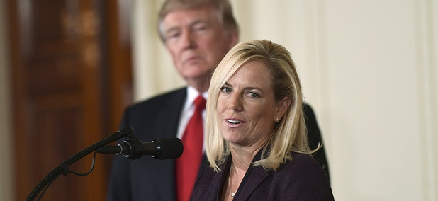 President Donald Trump, left, listens as Kirstjen Nielsen, right, speaks in the East Room of the White House in Washington after Trump announced that she is his choice to be the next Homeland Security Secretary.
