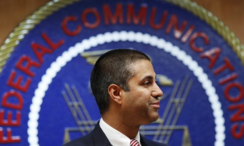 After a meeting voting to end net neutrality, FCC Chairman Ajit Pai smiles while listening to a question from a reporter, Thursday, Dec. 14, 2017.