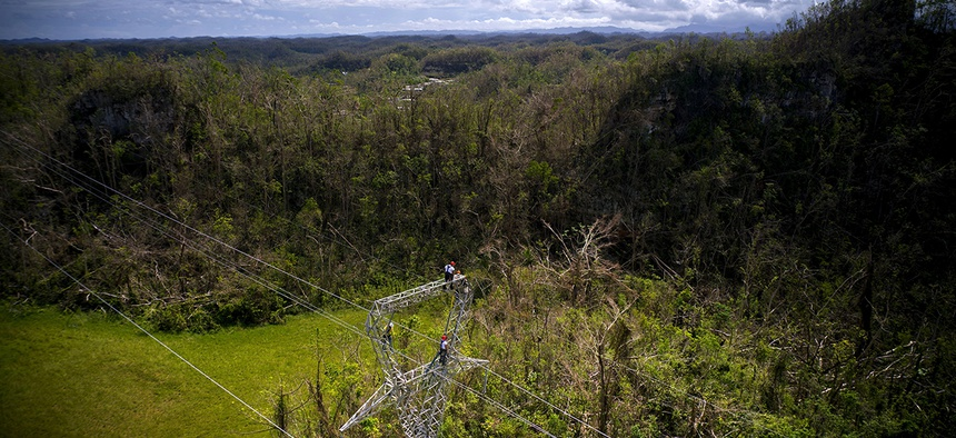 Electrical lineman work on transmission towers in Barceloneta, Puerto Rico.