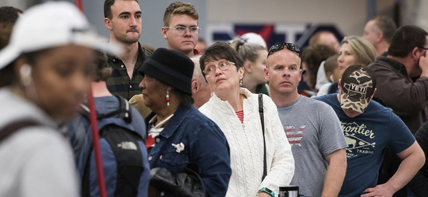 People wait in line to rebook flights at Hartfield-Jackson Atlanta International Airport , Monday, Dec. 18, 2017.