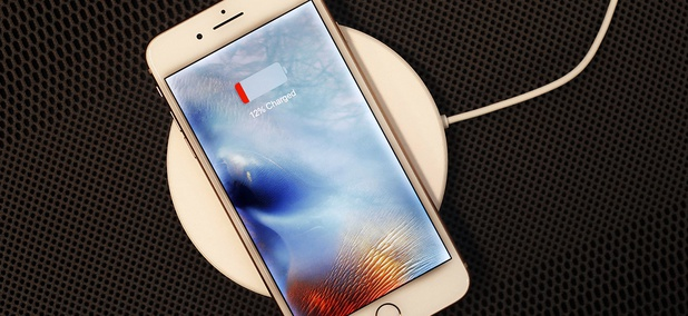In this Sept. 15, 2017, photo, the iPhone 8 Plus rests on a wireless charger.