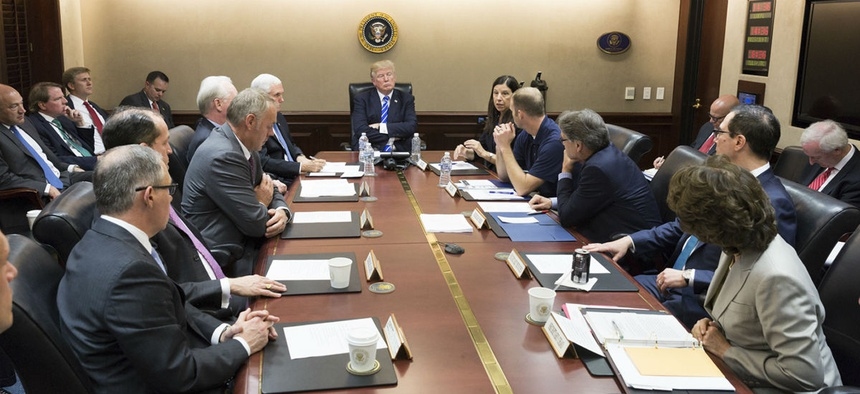 President Donald Trump, center, meets with members of his cabinet Sept. 26 in the Situation Room at the White House in Washington, as he receives the latest update on Hurricane Maria relief and recovery efforts.