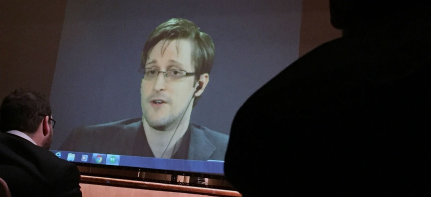 Edward Snowden speaks via video conference to people in the Johns Hopkins University auditorium February 2016.