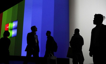 Attendees walk through the Samsung booth during CES International, Friday, Jan. 6, 2017, in Las Vegas.