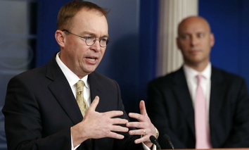 Director of the Office of Management and Budget Mick Mulvaney, left, speaks as Marc Short, White House director for legislative affairs, stands nearby during a press briefing at the White House, Saturday, Jan. 20, 2018.
