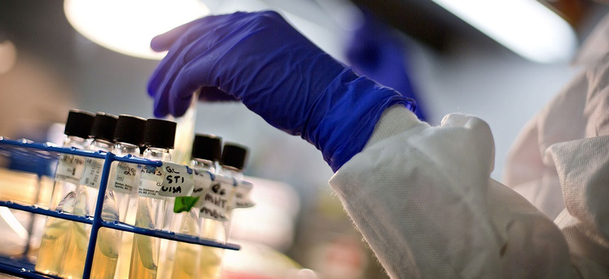 A microbiologist works with tubes of bacteria samples in an antimicrobial resistance and characterization lab within the Infectious Disease Laboratory at the Centers for Disease Control and Prevention in Atlanta.