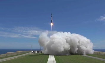 A Rocket Lab Electron booster lifts off from the company's Māhia Peninsula launch site in New Zealand on Jan. 21, 2018. The Electron rocket carried three small satellites into orbit for Rocket Lab customers.