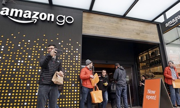 People stand outside an Amazon Go store Monday, Jan. 22, 2018, in Seattle. People stand outside an Amazon Go store Monday, Jan. 22, 2018, in Seattle.
