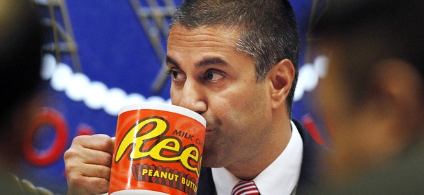 FCC Chairman Ajit Pai takes a drink from a mug during the meeting where the FCC voted on net neutrality, in Washington.