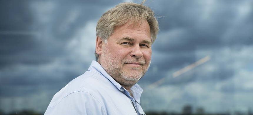 Eugene Kaspersky, Russian antivirus programs developer and chief executive of Russia's Kaspersky Lab, poses for a photo on a balcony at his company's headquarters in Moscow, Russia, Saturday, July 1, 2017.