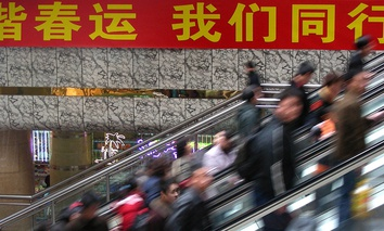 Passengers take moving staircases to waiting halls of a railway station in Zhengzhou, China.