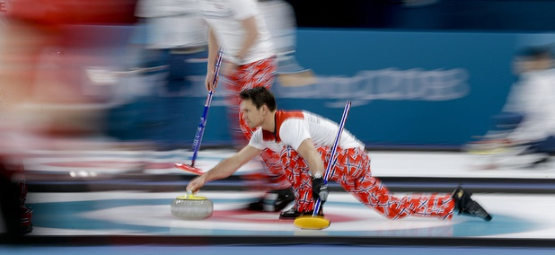 Norway's skip Thomas Ulsrud throw a stone during a men's curling match against Sweden at the 2018 Winter Olympics in Gangneung, South Korea.
