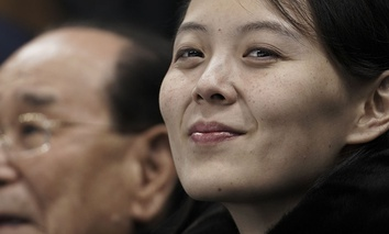Kim Yo Jong, sister of North Korean leader Kim Jong Un, right, and North Korea's nominal head of state Kim Yong Nam watch an Olympic hockey game.