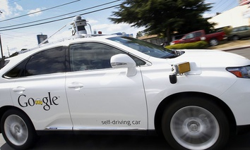 Google's self-driving Lexus car drives along street during a demonstration at Google campus in Mountain View, California.