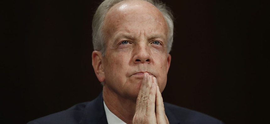 Sen. Jerry Moran, R-Kan., pauses before testifying during a Senate Judiciary Committee hearing.
