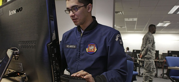 In this Feb. 20, 2013 photo, a cadet works at a large computer display inside a classroom at the Center for Cyberspace Research, where cyber warfare is taught, at the U.S. Air Force Academy, in Colorado Springs.