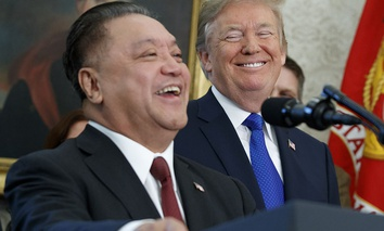 President Donald Trump smiles at Broadcom CEO Hock Tan during an event to announce that the company is moving its global headquarters to the United States, Thursday, Nov. 2, 2017.