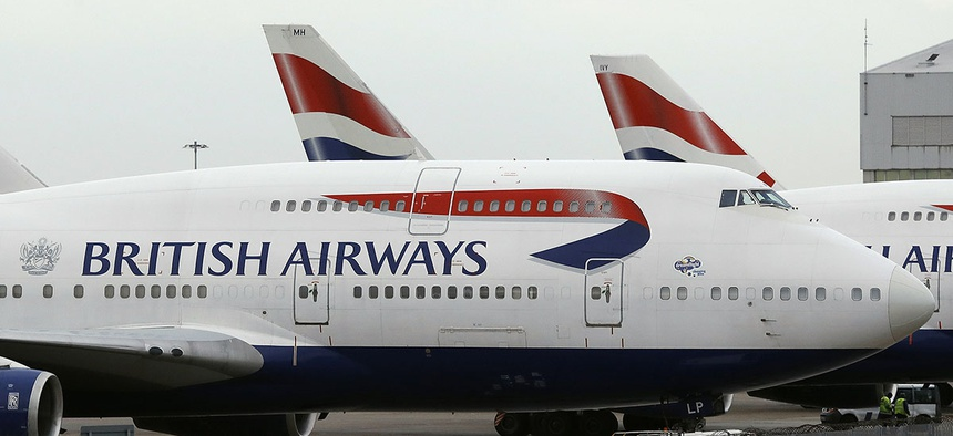 British Airways planes are parked at Heathrow Airport.