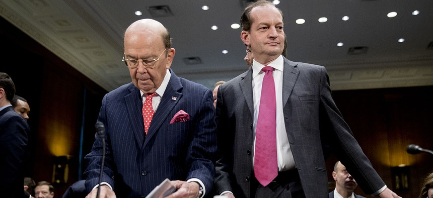 Commerce Secretary Wilbur Ross, center left, and Labor Secretary Alex Acosta, right, arrive before a Senate Committee on Commerce, Science, & Transportation hearing on infrastructure on Capitol Hill.
