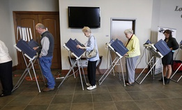 Voters fill the electronic voting machines to cast their ballots during the primary election at the precinct in the Highland Colony Baptist Church in Madison, Miss., on Tuesday, March 8, 2016.