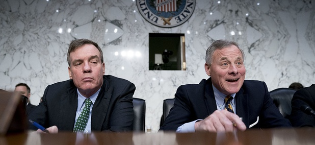 Senate Intelligence Chairman Richard Burr, R-N.C., right, accompanied by Committee Vice Chairman Mark Warner, D-Va.