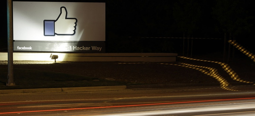 "The Facebook ""like"" symbol is on display on a sign outside the company's headquarters in Menlo Park, Calif."