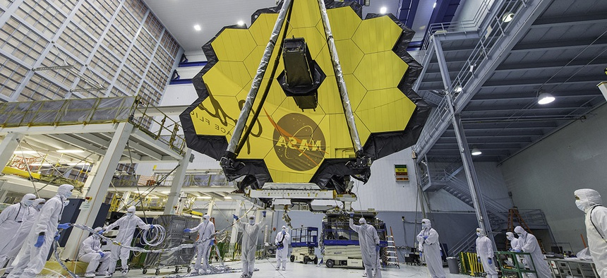 NASA technicians lift the mirror of the James Webb Space Telescope using a crane at the Goddard Space Flight Center in Greenbelt, Md.