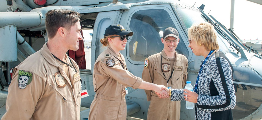 "Ellen Lord meets the ""Wildcards"" of Helicopter Sea Combat Squadron 23 during the International Air Show in the Dubai World Center in November."